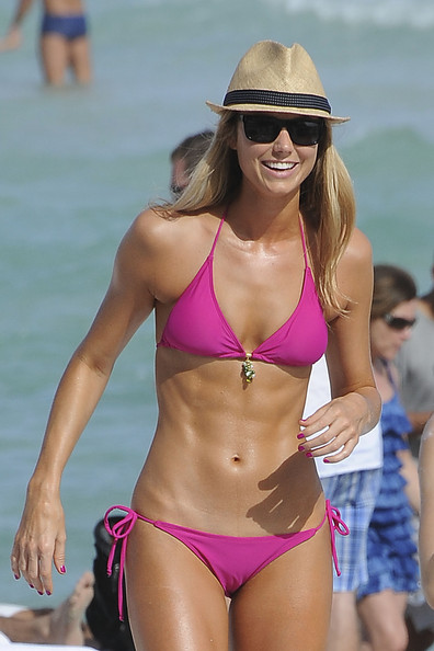 With her athletic body and Regular blond hairtype without bra (cup size 34B) on the beach in bikini