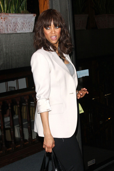 Supermodel Tyra Banks strutts out of Madeo restaurant in West Hollywood.