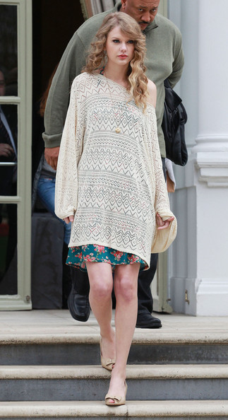 Taylor Swift Taylor Swift, in an off the shoulder crocheted sweater over a floral print dress, seen leaving her hotel in London to make an appearance at MTV Studios in London.