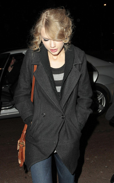 Taylor Swift Taylor Swift keeps her head down as she returns to her London hotel with her hands in her coat pockets.