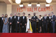 Zoe Saldana, Guillaume Canet, Clive Owen, Marion Cotillard, Jamie Hector, Lili Taylor, Domenick Lombardozzi and Mark Mahoney attending the premiere of 'Blood Ties' during the 66th Annual Cannes Film Festival at the Palais des Festivals in Cannes.
