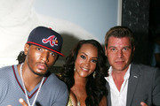 Vivica Fox and fiance Omar Slim White are seen with Tom Murro at a birthday party in Los Angeles.