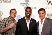 Chef Chris Nirschel  and Tom Murro pose for pictures with AJ Calloway at the 'Taste for Tennis' event in New York.