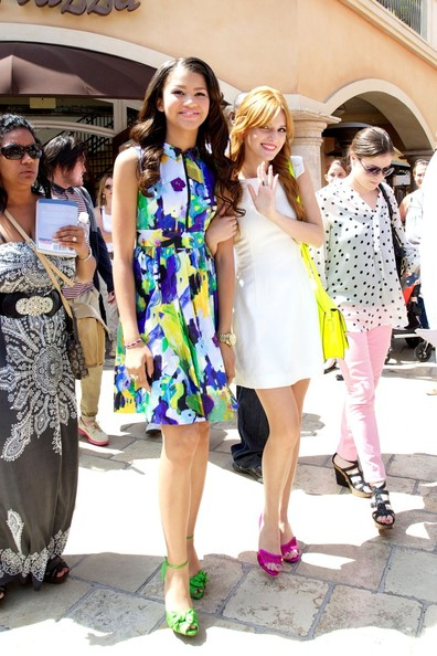 "Bella Thorne and Zendaya are seen leaving the Grove in West Hollywood after filming ""Extra."" The ""Shake It Up"" costars are dressed for summer in brightly colored frocks and neon heels."