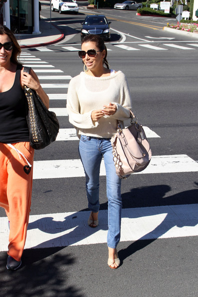 A beaming Eva Longoria runs across the street after having lunch at Cafe Med with friends. The 'Desperate Housewives' star, spotted recently smooching Penelope Cruz's younger brother Eduardo, headed into the BCBG Maz Azria store to do a bit of shopping.