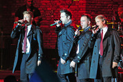 The boys of Westlife sing in concert at the 2011 Hampton Court Palance Festival in London.