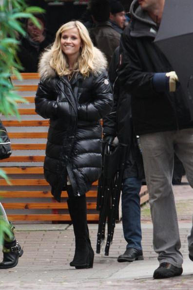 "A bundled up Reese Witherspoon flashes a smile on the set of the upcoming McG-directed film ""This Means War."