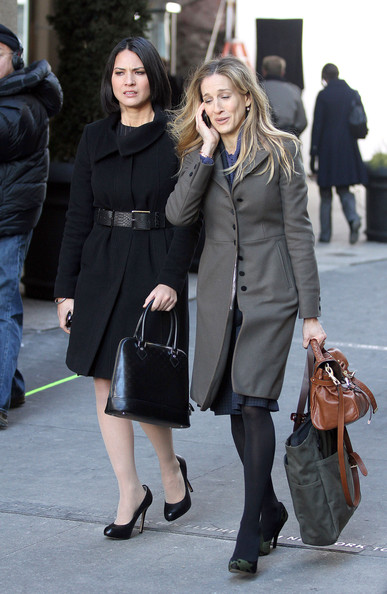 "A disheveled looking Sarah Jessica Parker films a scene with Olivia Munn for their upcoming film ""I Don't Know How She Does It"". Parker's new role is not a huge stretch from real life as she will be playing a working mother in the new film."