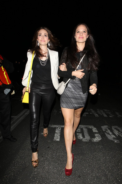 "A leather-panted Emmy Rossum heads to the Prince concert in LA with a gal pal. The ""Shameless"" star accessorised her rock outfit with leopard print peep toes and an acid yellow Kate Spade mini satchel bag."