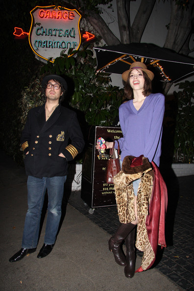Kemp Muhl A nautical Sean Lennon and girlfriend Kemp Muhl wait for the valet to return their vehicle (maybe a yellow submarine?). Sean, who was wearing a naval jacket complimented by a bowler hat, and his model girlfriend, who was keen to show photographers her mechanical monkey, had been enjoying a night out at Chateau Marmont.