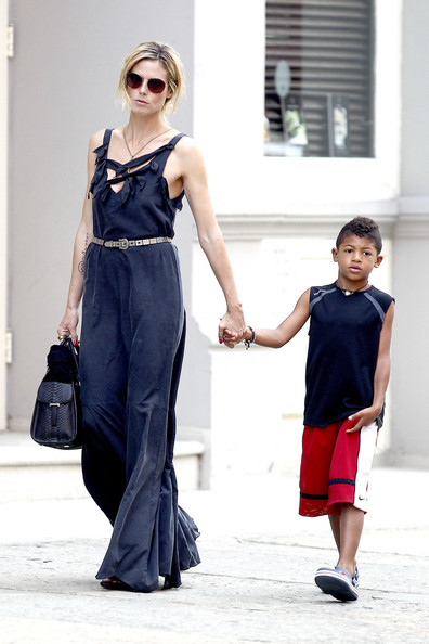 A perfectly groomed Heidi Klum, looking every inch the supermodel, walks her kids to their daycare centre in New York. The mother-of-four walked hand-in-hand with her eldest son Henry while a nanny pushed Johan in a pram.