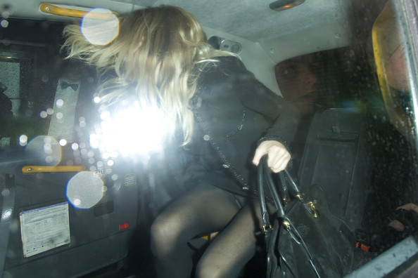 Sienna Miller exposes her tights and pants as she climbs into a car as she leaves the Matthew Williamson London Fashion Week afterparty held at The Ivy Club in London. The star of