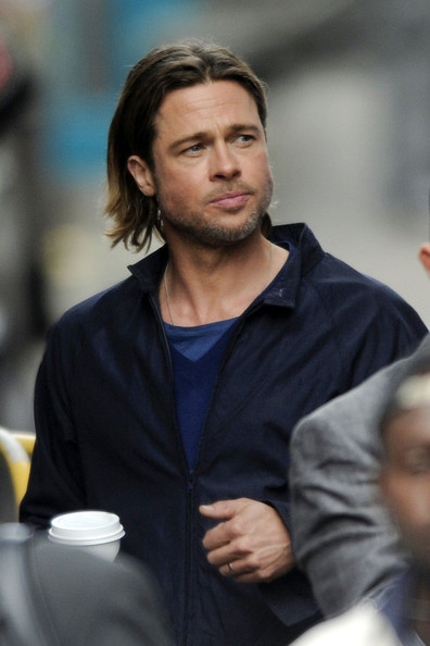 "An unshaven Brad Pitt fiilms scenes for ""World War Z"" on day two of the Glasgow film set. Brad was joined in the Scottish city by his partner Angelina Jolie and their six children."