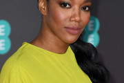 Naomi Ackie Long Braided Hairstyle