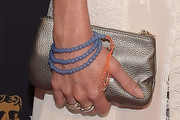 Cressida Bonas Metallic Clutch