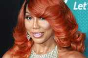 Tamar Braxton Feathered Flip